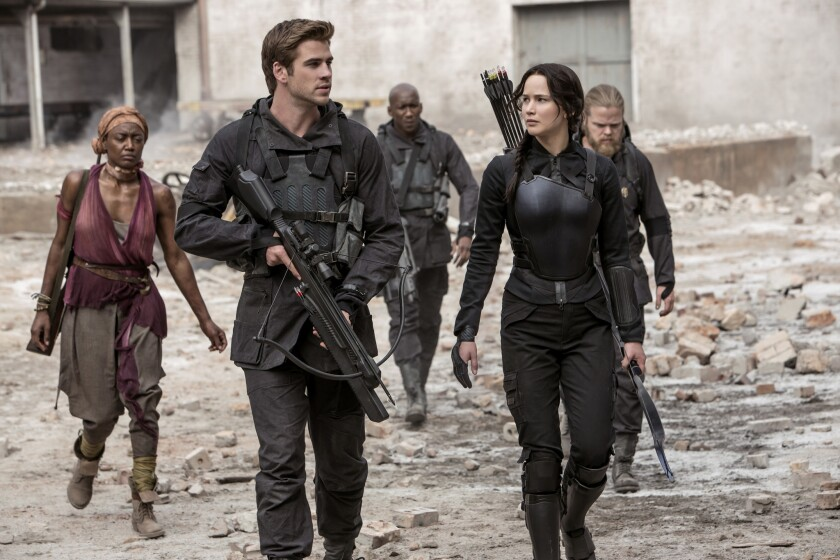 """Liam Hemsworth plays Gale Hawthorne and Jennifer Lawrence stars as Katniss Everdeen in """"The Hunger Games: Mockingjay -- Part 1."""""""