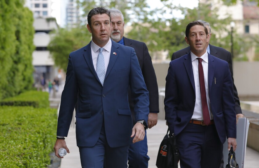 Duncan Hunter walked to court where he was sentence to 11 months in prison in March