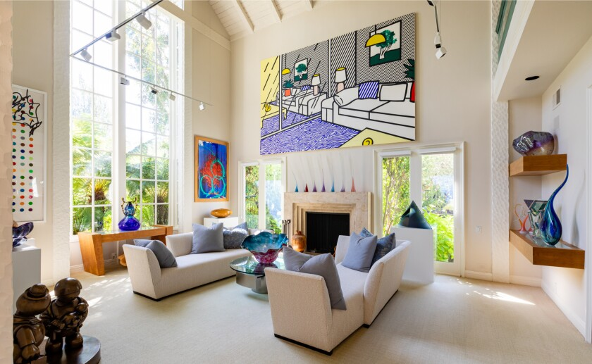 The living room of Ted Knight's former home has gallery walls for showcasing artwork.