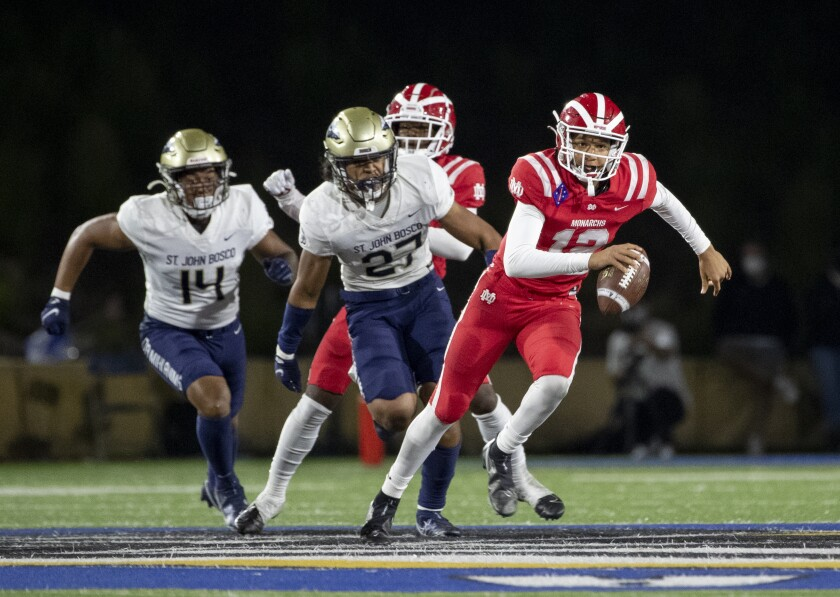 Mater Dei quarterback Elijah Brown scampers for extra yardage while evading the pass rush.