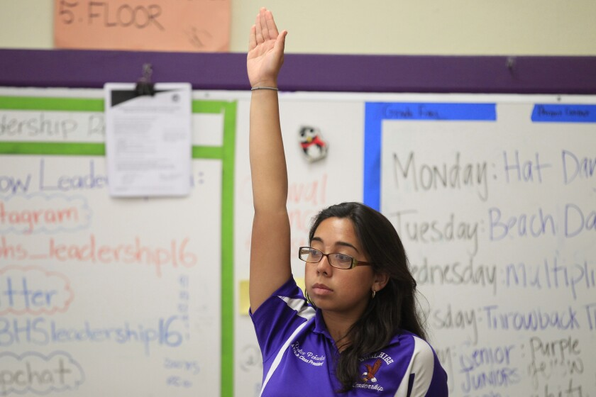 Dulce Penuelas, 17, raises her hand during leadership class at Bell High School, in Bell, Calif. Latino and black students who passed their Advanced Placement tests outperformed their peers, new exam scores show.