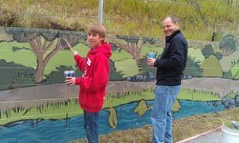 TVIA volunteers Robert Shearer and Christian Shearer, father and son, enjoying their day painting.