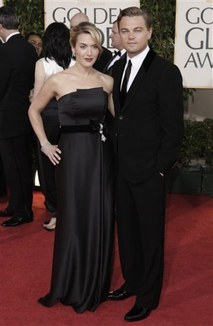 Kate Winslet, left, and Leonardo DiCaprio arrive at the 66th Annual Golden Globe Awards on Sunday, Jan. 11, 2009, in Beverly Hills, Calif. (AP Photo/Matt Sayles)