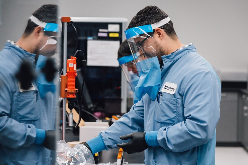 A Helix lab technician works at the company's high complexity clinical lab in San Diego.