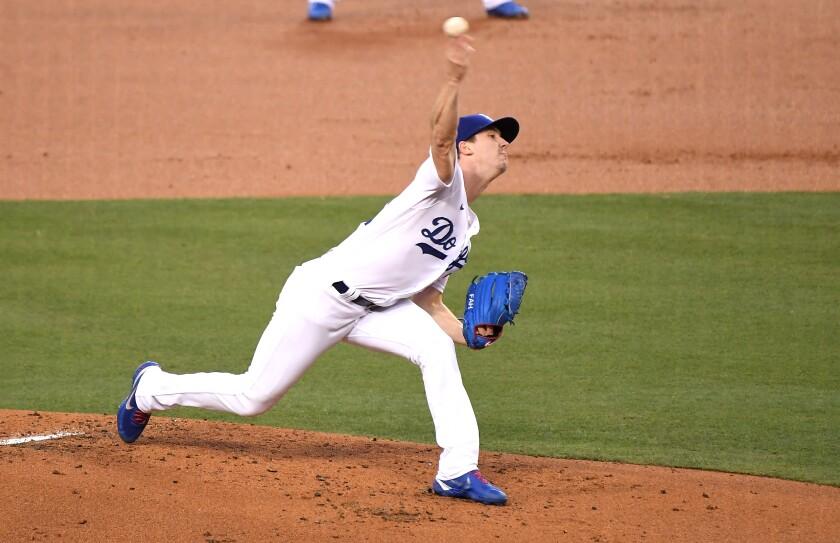 Dodgers pitcher Walker Buehler delivers.