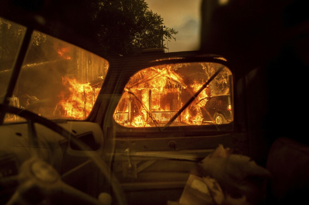 Flames are seen through the window of an automobile