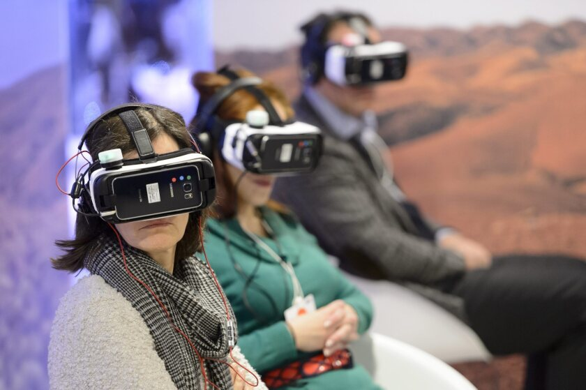 Participants try out virtual reality glasses at the World Economic Forum in Davos, Switzerland, on Jan. 20.