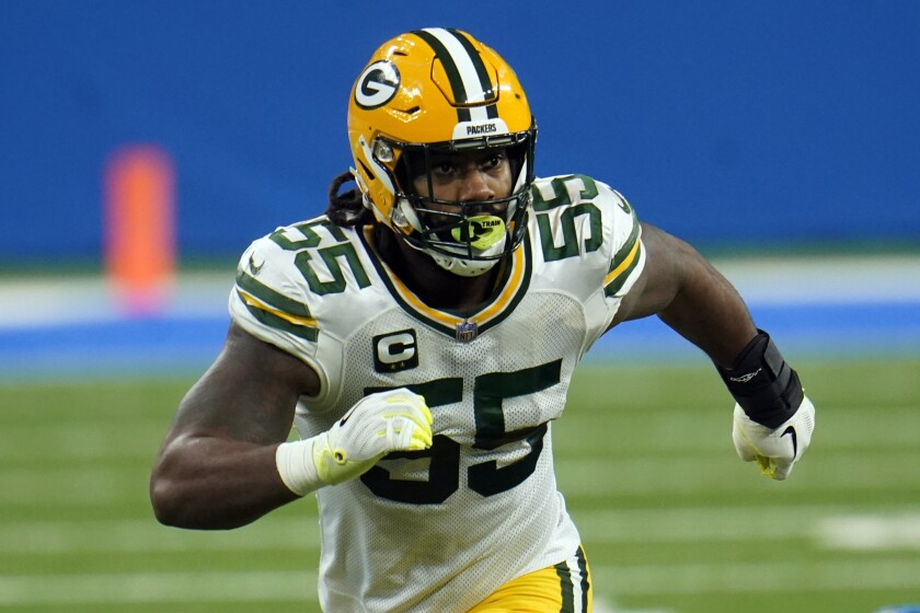 FILE- In this Dec. 13, 2020, file photo, Green Bay Packers outside linebacker Za'Darius Smith (55) plays against the Detroit Lions during the first half of an NFL football game in Detroit. The back issue that bothered Smith throughout the preseason will now force the Packers to play without their Pro Bowl pass rusher for the next few weeks. (AP Photo/Paul Sancya, File)