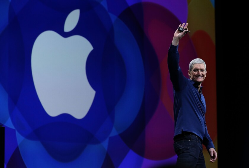Apple Chief Executive Tim Cook delivers the keynote address during Apple Worldwide Developers Conference in June 2015 in San Francisco.