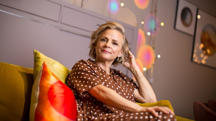 """Amy Sedaris lounges on a couch at a home decor store in New York City. Sedaris stars in the TruTV comedy """"At Home With Amy Sedaris,"""" a sketch-comedy show loosely based on her off-kilter how-to books."""
