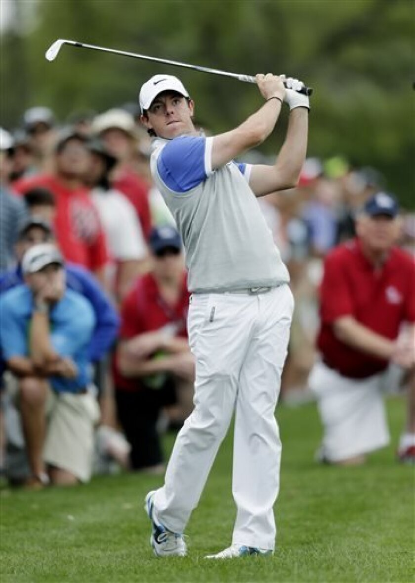 Rory McIlroy, of Northern Ireland, watches his shot from the rough on the first hole during the final round of the Texas Open golf tournament, Sunday, April 7, 2013, in San Antonio. (AP Photo/Eric Gay)
