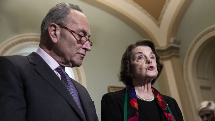 Senate Minority Leader Charles E. Schumer and Senate Judiciary Committee ranking member Dianne Feinstein discuss the FBI report on Brett Kavanaugh as they meet with reporters in the Capitol on Oct. 4.