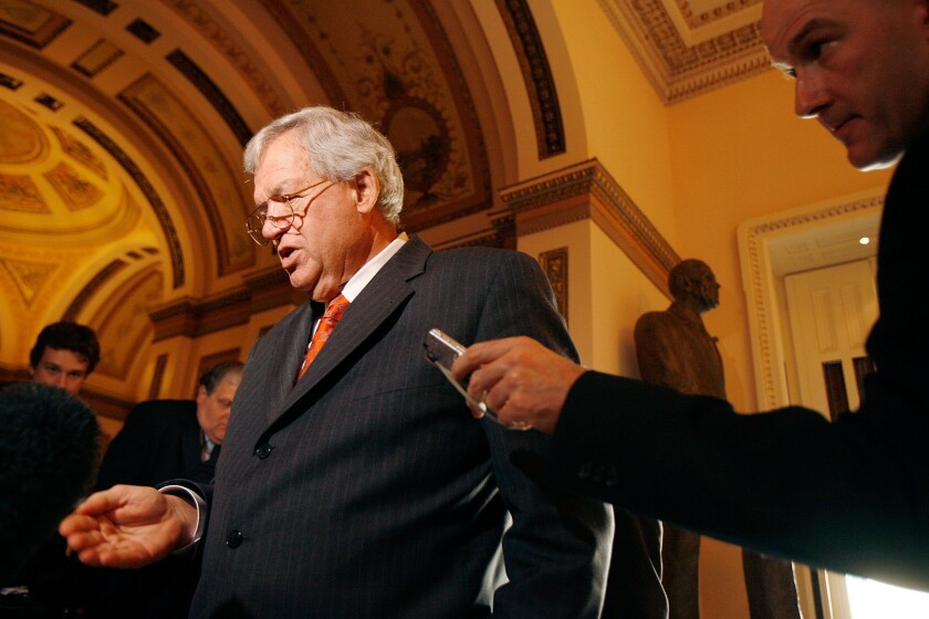Dennis Hastert is shown in this 2007 file photo, talking to reporters after announcing his resignation from Congress.