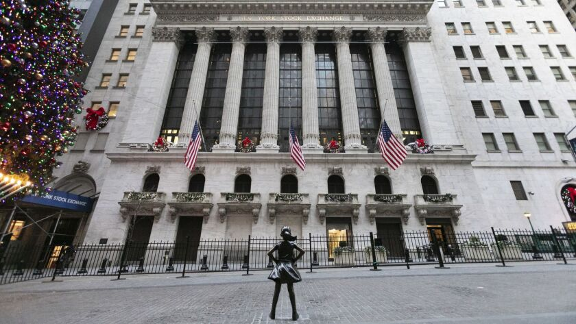 The Fearless Girl statue stands at its new location in front of the New York Stock Exchange.