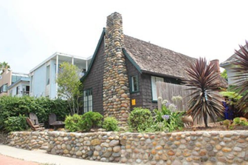 This 1928 WindanSea cottage, with its notable cobblestone chimney and wall, has been designated historic and will be incorporated into new design plans for the property. File