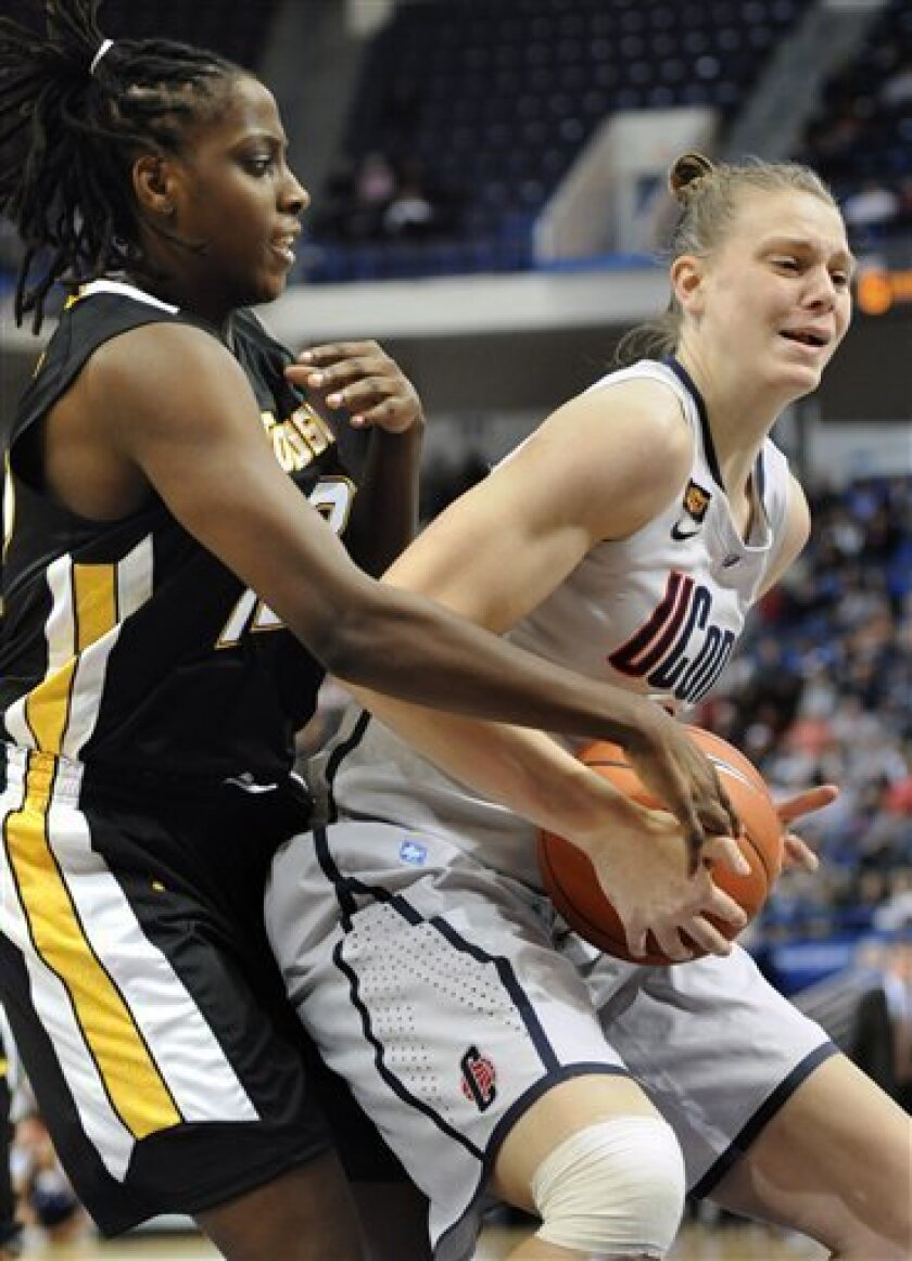 Connecticut's Heather Buck, right, is guarded by Towson's Krystin Fields, left, in the first half of an NCAA college basketball game in Hartford, Conn., Wednesday, Nov. 30, 2011. (AP Photo/Jessica Hill)