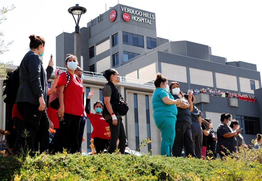 Healthcare workers thank police and fire personnel who came to show their appreciation for USC Verdugo Hills Hospital employees, Wednesday, April 15, 2020.
