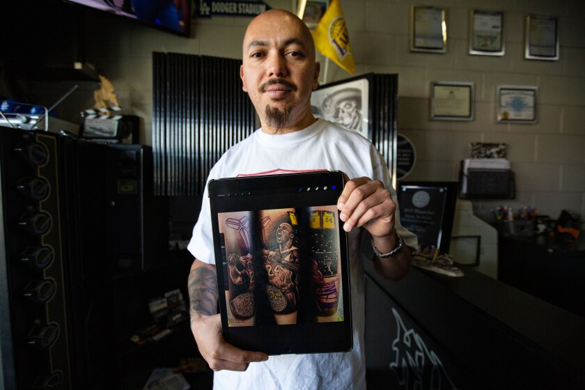 Jose Guijosa with photos of a Kobe Bryant-themed tattoo