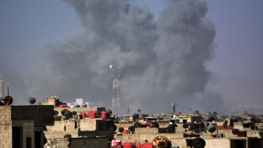 Smoke billows after April 20 Syrian regime strikes targeting Islamic State in the Palestinian camp of Yarmouk near Damascus.