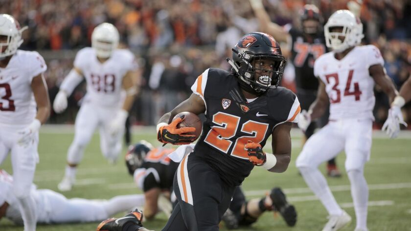 Oregon State running back Jermar Jefferson (22) breaks off a long run against Washington State.