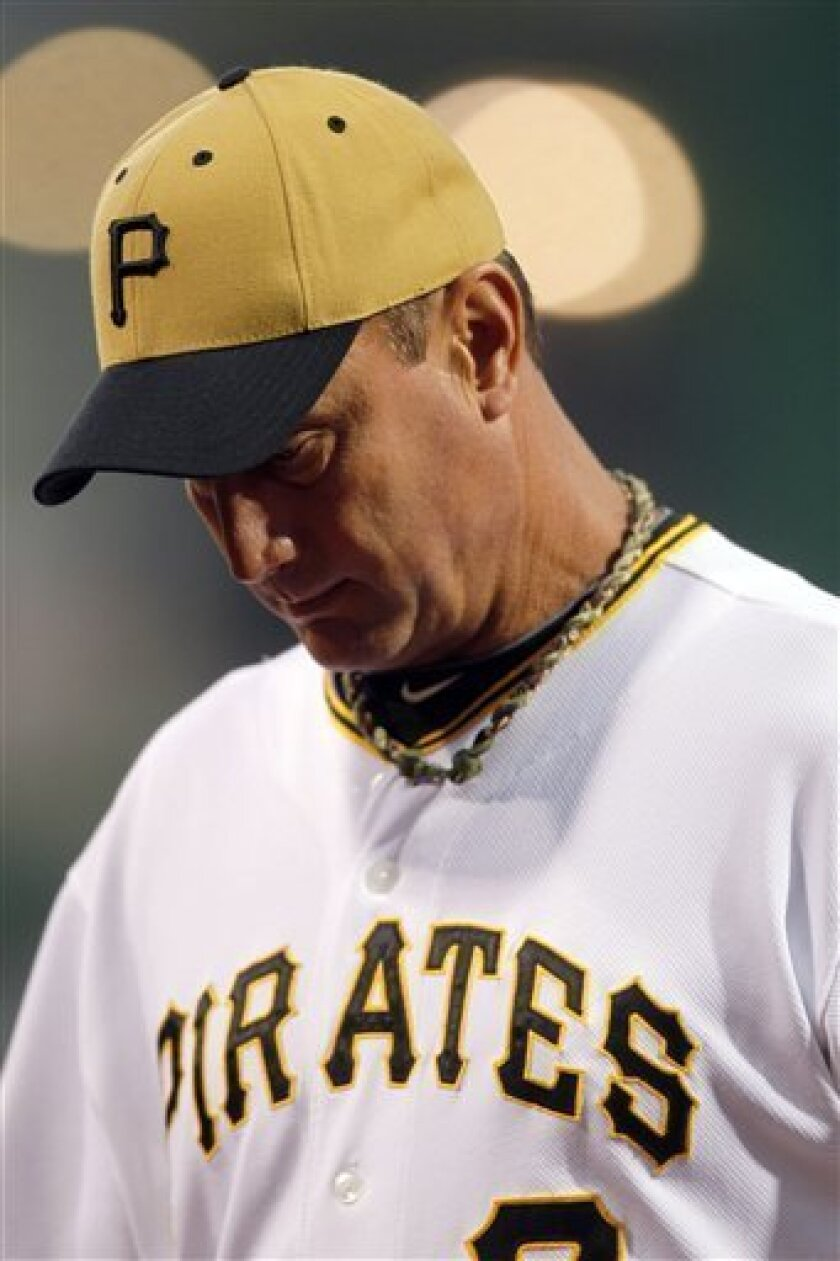 FILE - This Sept. 8, 2010, file photo shows Pittsburgh Pirates manager John Russell during a baseball game against the Atlanta Braves in Pittsburgh. The Pirates, Monday, Oct. 4, 2010, fired Russell, whose teams equaled a franchise record by losing 299 games in three seasons. (AP Photo/Keith Srakocic, File)
