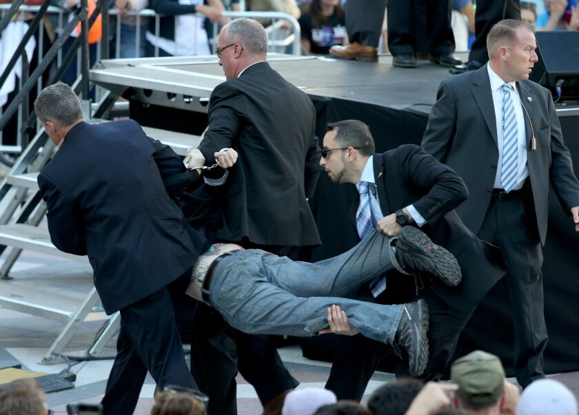 Secret Service agents remove a man from the crowd during a campaign rally for Democratic presidential candidate, Sen. Bernie Sanders, I-Vt., at Frank Ogawa Plaza in Oakland, Calif., on Monday, May 30, 2016. A group of animal rights activists briefly interrupted the Sanders rally in Northern Califor