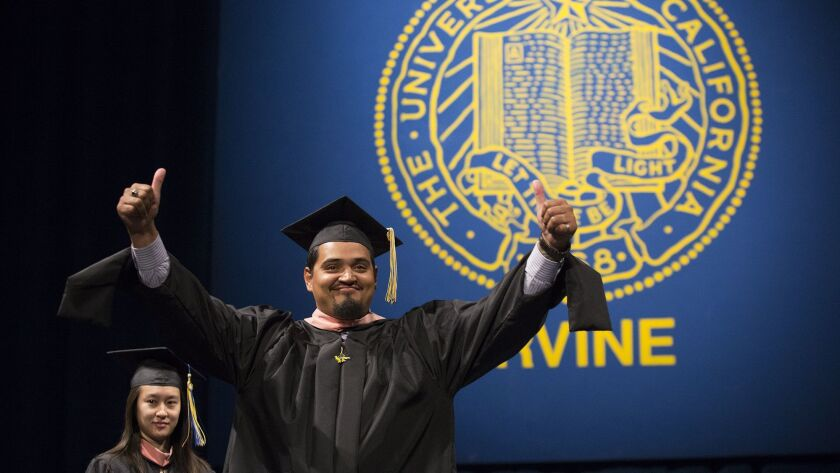 Ivan Delgadillo celebrates during the 2017 commenement ceremony for the School of Social Ecology at