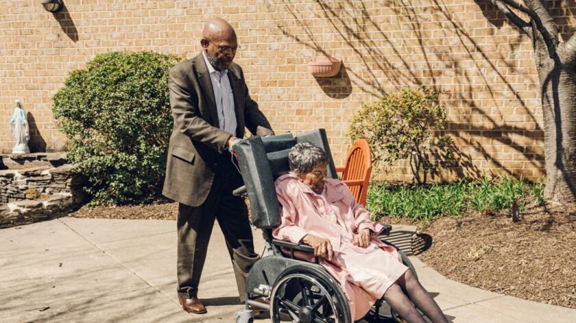 James Dotson with his mother Edith Dotson at her assisted living facility in Burtonsville, Md.