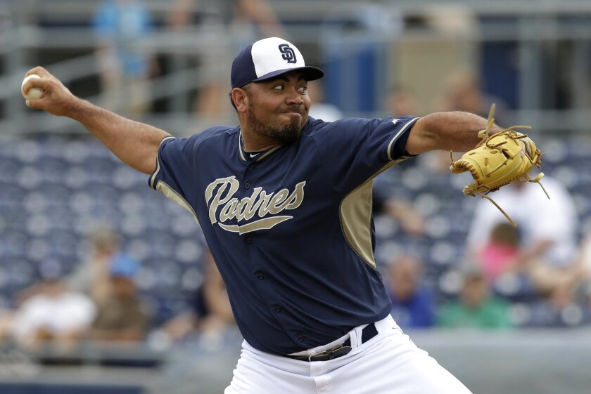 San Diego Padres relief pitcher Joaquin Benoit works against the Texas Rangers in the fifth thinning of an exhibition baseball game.