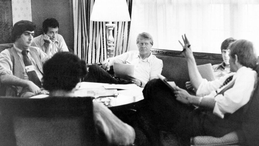 Jimmy Carter, center, meets with staff including Patrick Caddell, seated in the back left, at the Americana Hotel in New York on July 14, 1976.