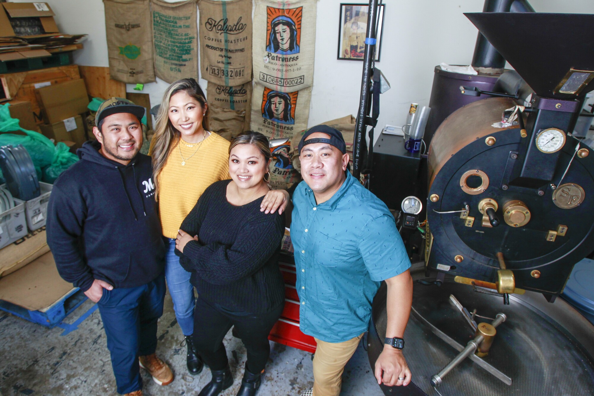 Mostra founders (from left) Sam Magtanong, Jelynn Malone, Beverly Magtanong and Mike Arquines in the company's Carmel Mountain Ranch roasting facility.