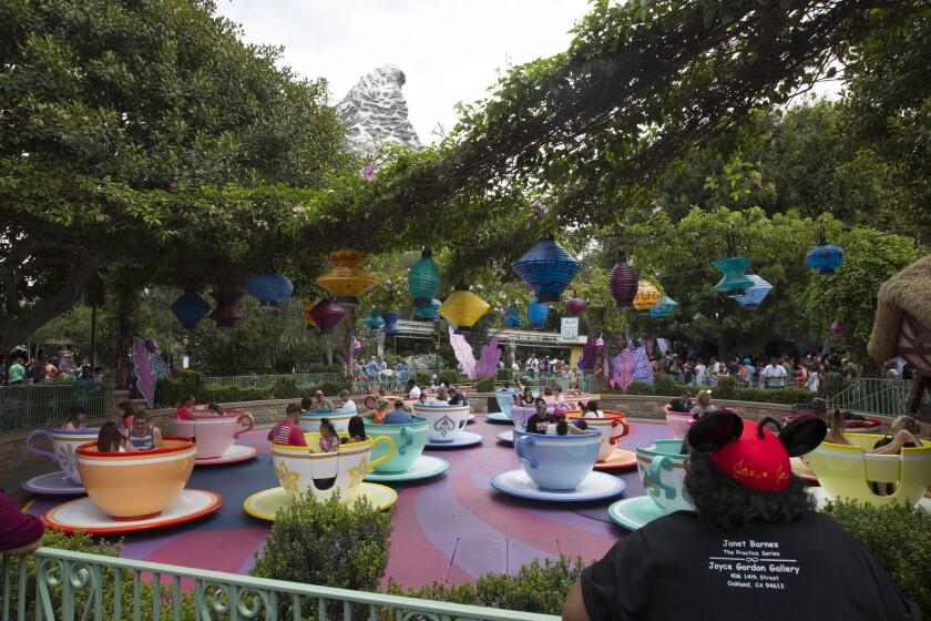 Visitors ride the Mad Tea Party cupsat Disneyland in June 2015.