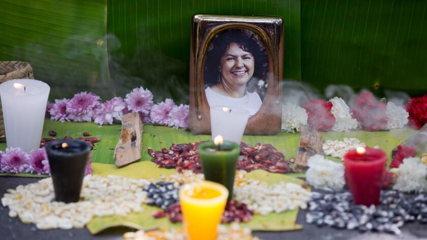 A makeshift alter honors environmentalist Berta Caceres