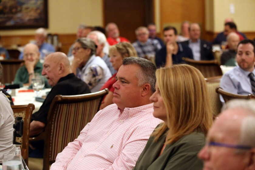 Guests listen to guest speaker Ronert Horry, former NBA basketball player and winner of seven NBA championship titles, during the YMCA Quarterback Club Meeting at the Oakmont Country Club banquet facility in Glendale, Ca., Tuesday, October 15, 2019. (photo by James Carbone)