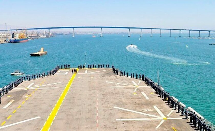 Sailors man the rails on the Peleliu Friday as the ship approaches the Coronado Bridge.