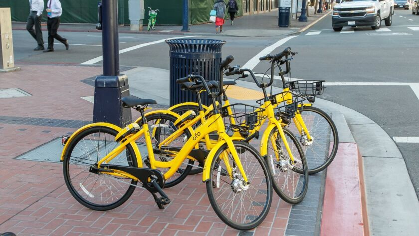 Ofo bikes parked along Broadway in downtown San Diego in March.