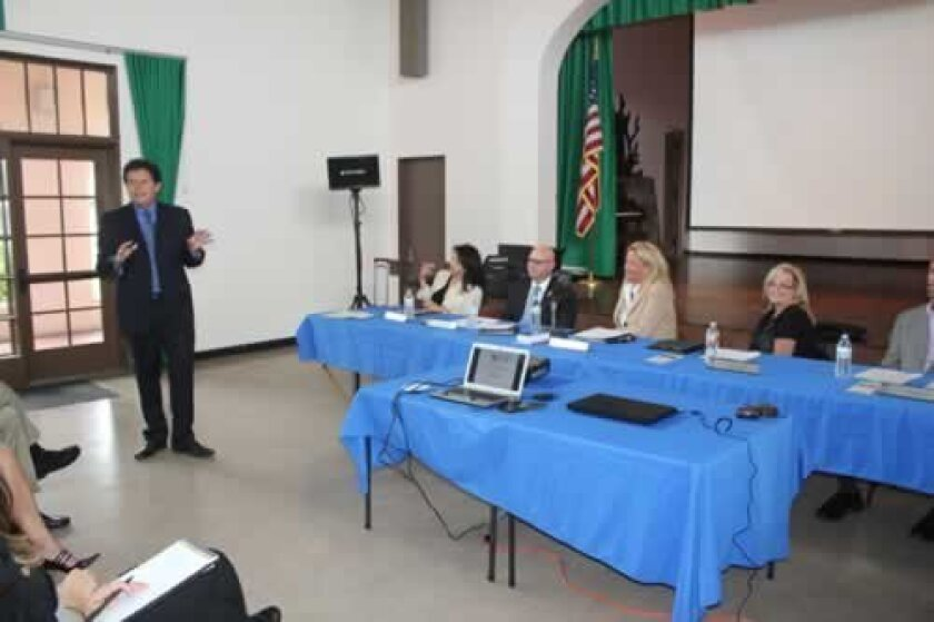 State Sen. Marty Block (D-39th), above left and at right, addresses the La Jolla Town Council Aug. 8. The former state Assembly member and San Diego State University dean said he was 'making the rounds' to learn about districts he hasn't formerly represented. Block will hold a town hall for constit