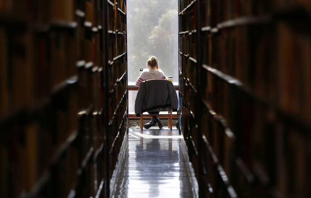 A student studies at Geisel Library at UC San Diego in April 2019.