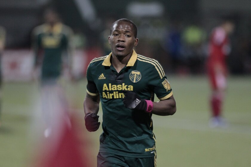 In this Nov. 22, 2015, photo, Portland Timbers forward/midfielder Darlington Nagbe (6) runs during the second half of the first leg of the MLS soccer Western Conference championship against FC Dallas in Portland, Ore. Things couldn't be better for Darlington Nagbe. The 25-year-old became a U.S. citizen in September, he's just returned from his first call-up with the U.S. national team, and his Portland Timbers are rolling in the MLS Cup playoffs. To top it off, Nagbe and his wife are expecting a son next month. (AP Photo/Steve Dipaola)