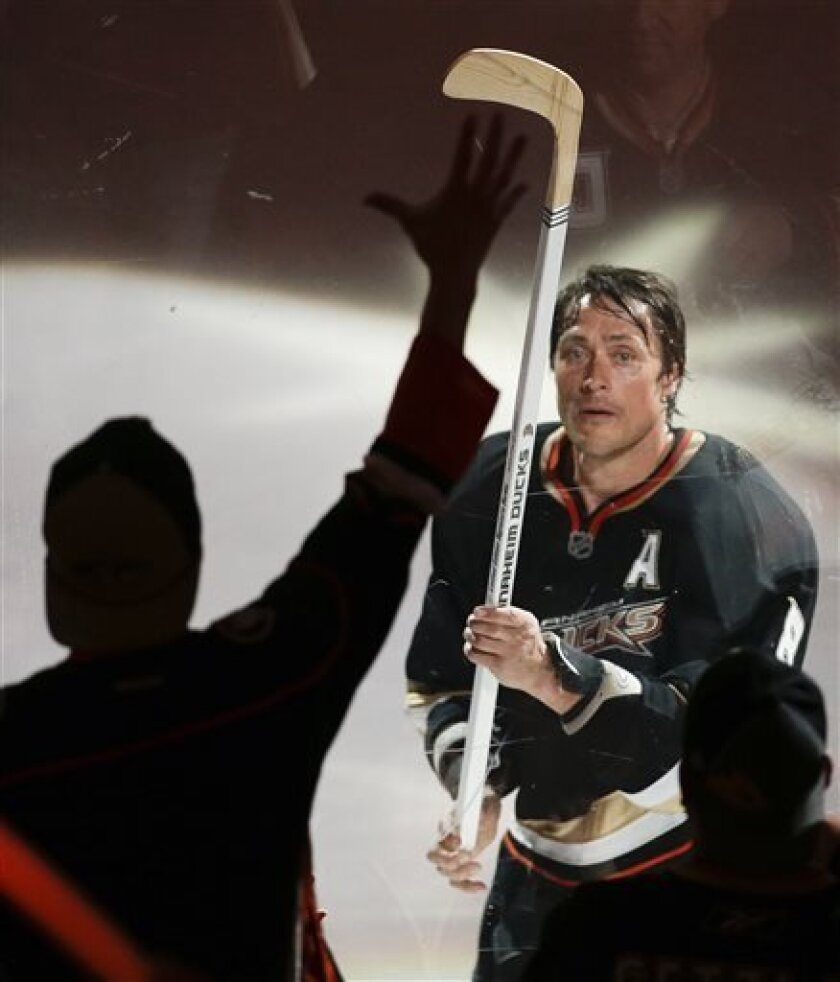 Anaheim Ducks right wing Teemu Selanne gives his stick to a fane after their win against the Detroit Red Wings during Game 1 of their first-round NHL hockey Stanley Cup playoff series in Anaheim, Calif., Tuesday, April 30, 2013. (AP Photo/Chris Carlson)