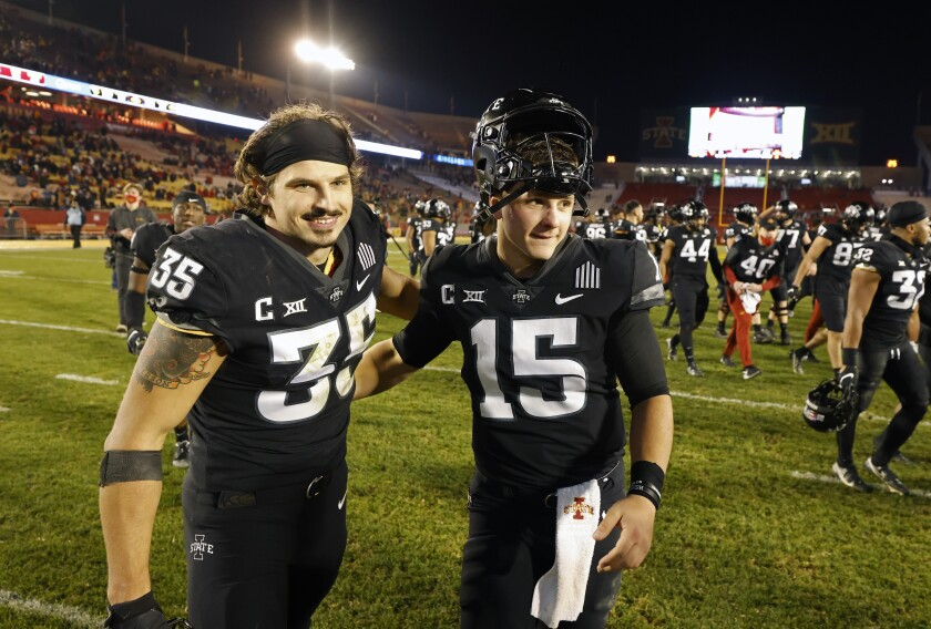 Iowa State linebacker Jake Hummel, left, and quarterback Brock Purdy, right, celebrate their 42-6 win over West Virginia after an NCAA college football game, Saturday, Dec. 5, 2020, in Ames, Iowa. (AP Photo/Matthew Putney)