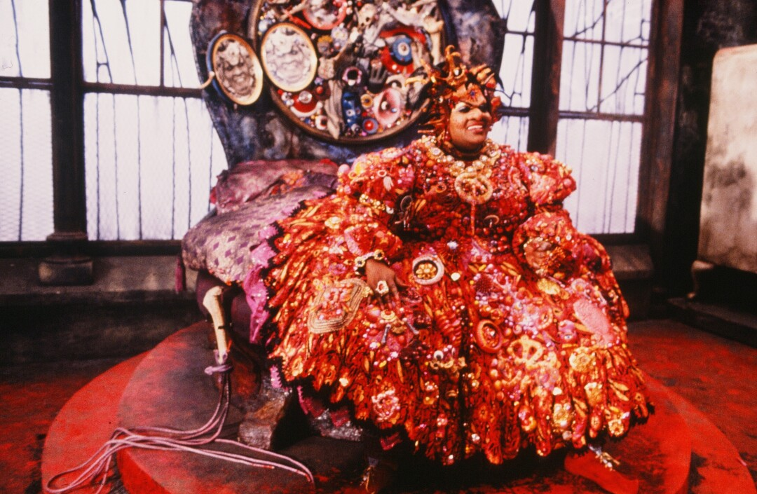 """Mabel King as Evillene wears a highly decorated red dress in Sidney Lumet's 1978 film """"The Wiz."""""""