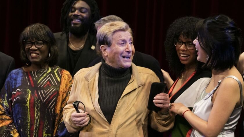 Writer John Rechy visits with other prize winners, including Innovator's Award winner Glory Edim, second from right, at USC's Bovard Auditorium.