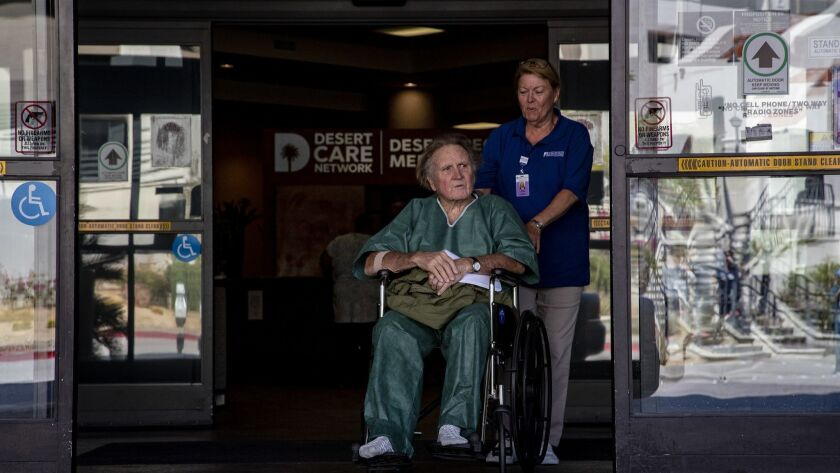PALM SPRINGS, CA - APRIL 27, 2018: David Sewell, 76, is wheeled out of Desert Regional Medical Cent