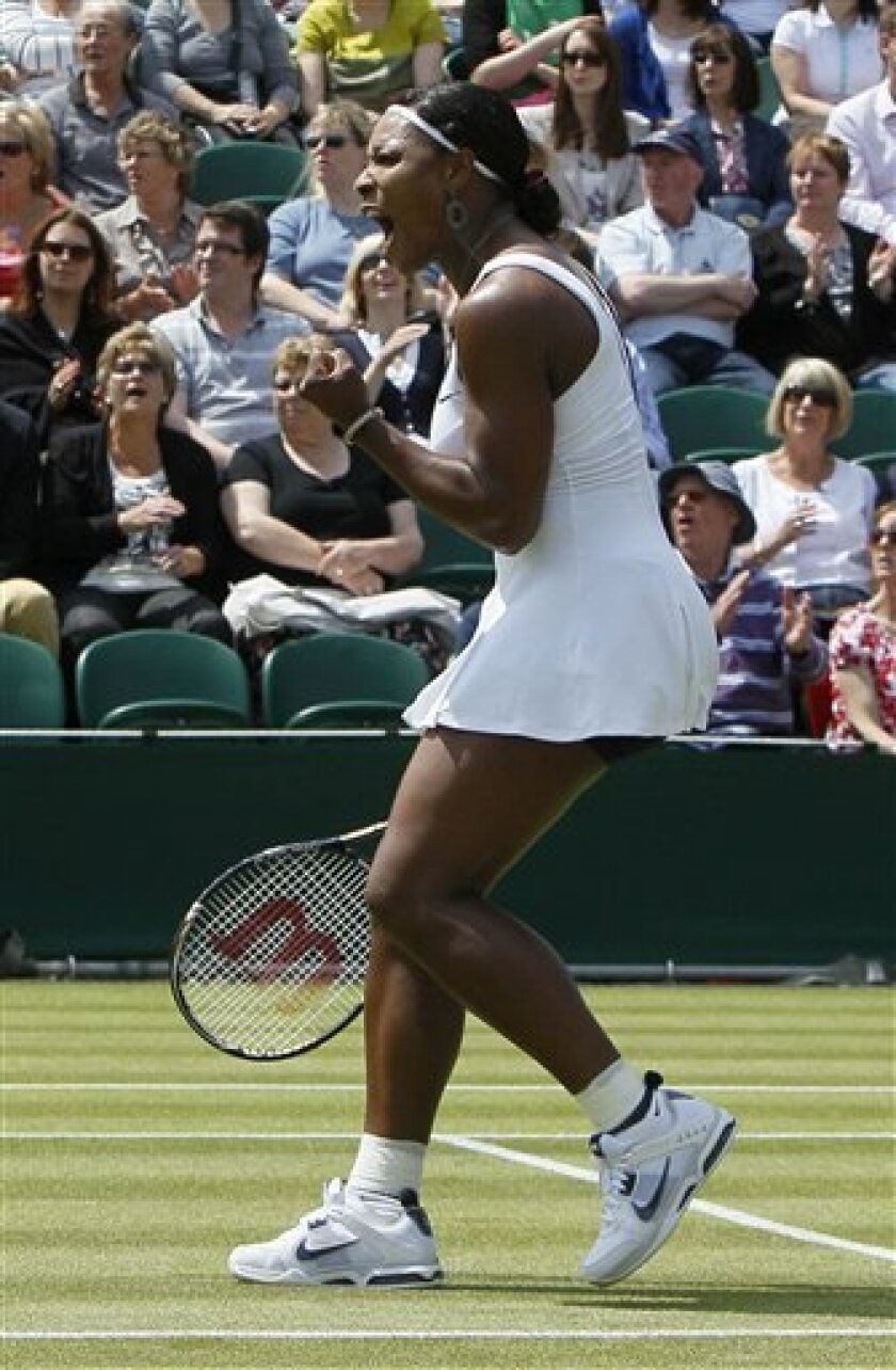 Serena Williams of the US reacts during the match against Romania's Simona Halep at the All England Lawn Tennis Championships at Wimbledon, Thursday, June 23, 2011. (AP Photo/Alastair Grant)