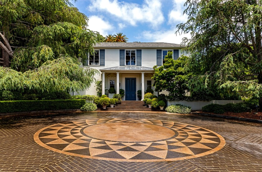 The Brentwood estate featured as Home of the Week sits on nearly two acres with an oval-shaped swimming pool, staff quarters and a security building.