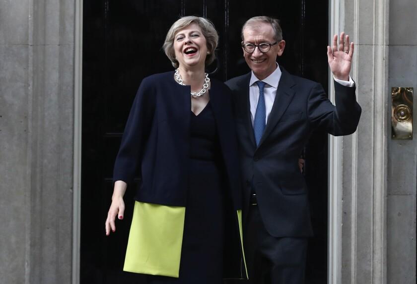 British Prime Minister Theresa May and husband Philip May outside 10 Downing Street.