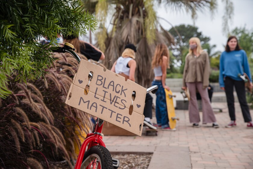 "A ""Black Lives Matter"" sign hangs on a bike on June 21, 2020, in Encinitas."