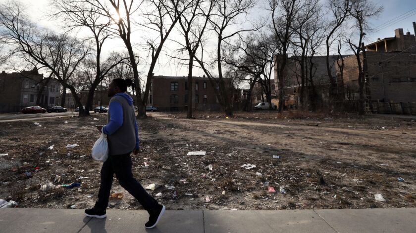 A vast vacant lot on Pulaski Road at Monroe Street in Chicago is seen on Sunday, March 18, 2018. The