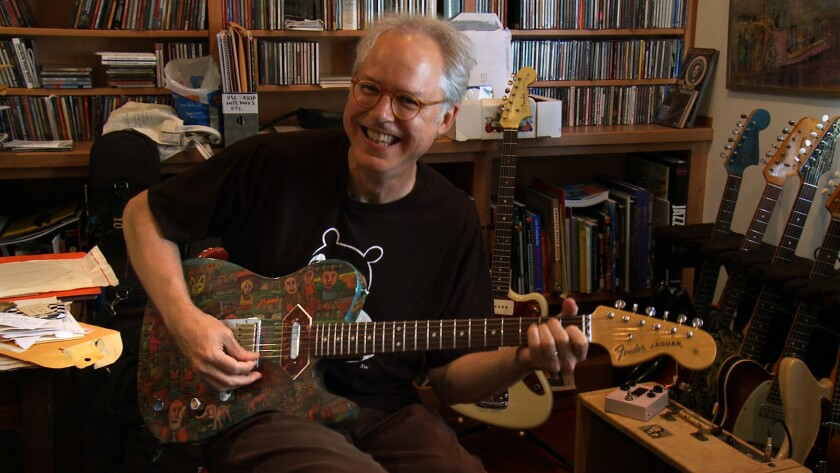 """Bill Frisell with a guitar hand-painted by friend Claude Utley in the documentary """"Bill Frisell: A Portrait."""""""